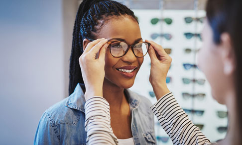 Women getting fitted for eyeglasses